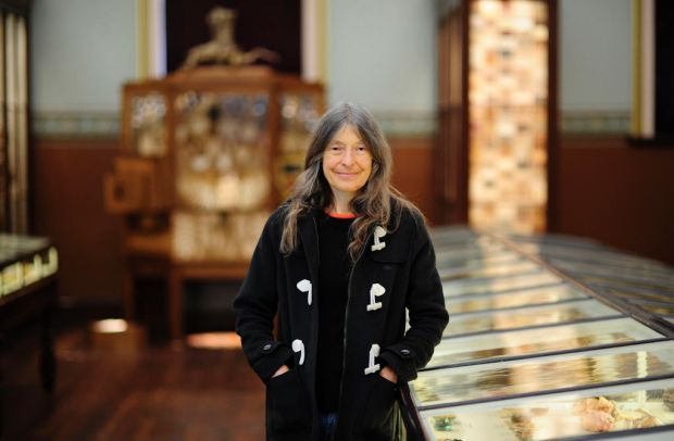 South Australian artist Fiona Hall with one of her works (Grove cabinet) on display at the Botanic Gardens Museum of ...