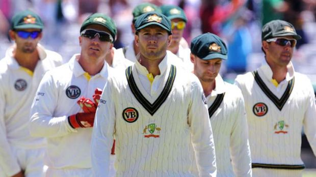 Long faces after one of the shortest Test innings on record ... captain Michael Clarke leads his Australian team from ...