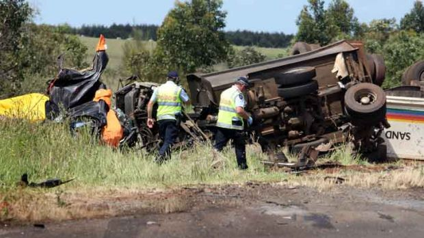Emergency services personnel were confronted with a truck in flames after a crash with a sedan left five people dead ...