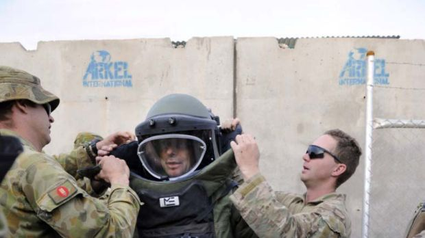Hurt Locker style ... officers from the explosive ordinance disposal and weapons intelligence teams kit out Tony Abbott ...