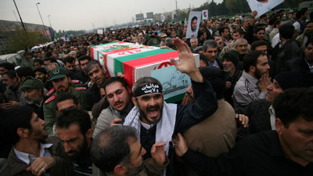 Iranians carry the coffin of a soldier killed at Alghadir. <i>Photo: AP</i>