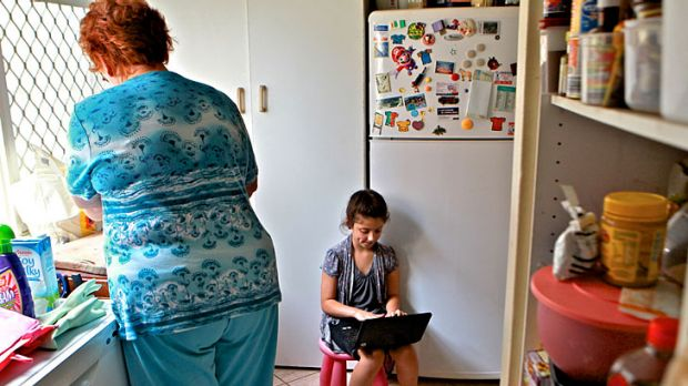 Taking care ... Niloofar Veiszadeh, 8, uses her laptop in the kitchen. Australian children are among the most prolific ...