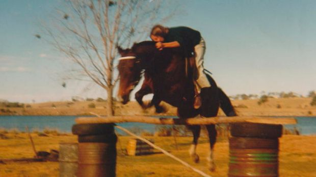 Mears, age 14, jumping one of her horses at her childhood home in Grafton.