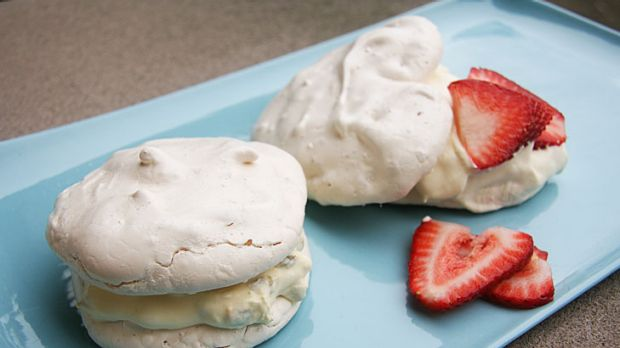 Versatile dessert ... Round meringues with passionfruit cream, and heart-shaped meringues with strawberries and cream.