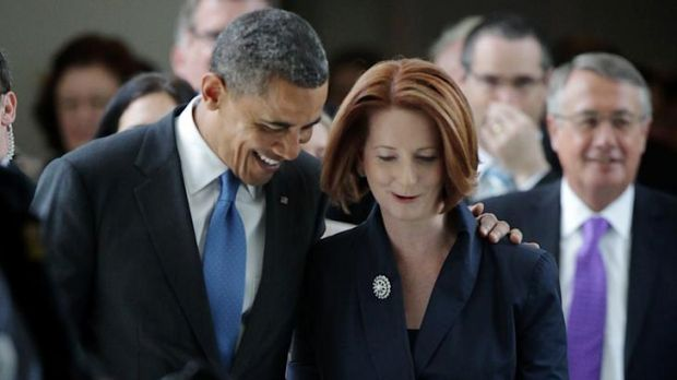 Close allies: Julia Gillard and Barack Obama leave the House of Representatives after the President's address yesterday.