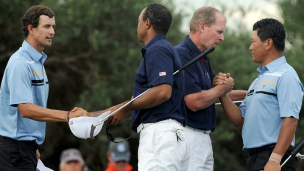 In the bag ... Tiger Woods and Steve Stricker concede to K.J Choi and Adam Scott.