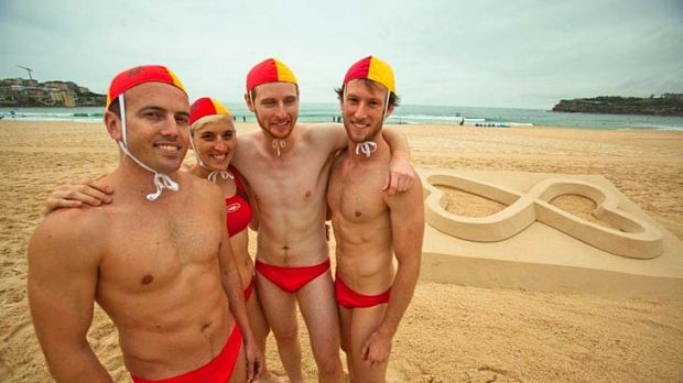 """""""The right to be"""" ... the new look Sydney Mardi Gras logo is unveiled at Bondi Beach yesterday."""