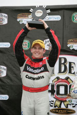 Past glory: Lee Holdsworth holds the trophy aloft after winning the Jim Beam 400 in 2007.
