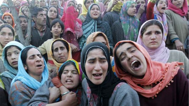 Families scarred by violence ... women mourn at a funeral in Khan Sahib, west of Srinagar, after one person was killed ...