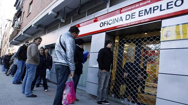 Disquieting: unemployed workers wait outside a government job centre in Madrid.