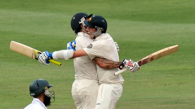 Australian cricketers Mitchell Johnson (left) and Patrick Cummins celebrate victory in the second Test against South ...