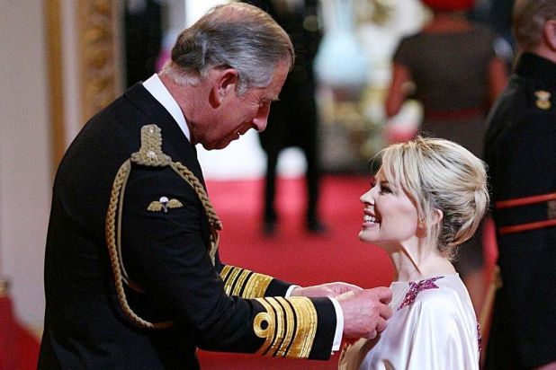 Kylie Minogue receiving her OBE from Britain's Prince of Wales  for services to music, July 3 2008.