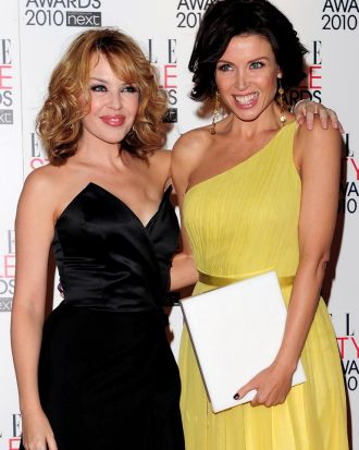 Kylie Minogue poses with Dannii Minogue and her TV Star award at the The ELLE Style Awards 2010.