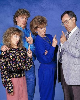 Kylie Minogue, Craig McLachlan and characters Madge and Harold Bishop from Neighbours.