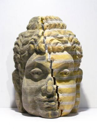 """One Buddha, Two Systems"": mixed media sculpture  made from Chinese and English telephone directories, by Chen Long-bin, ..."
