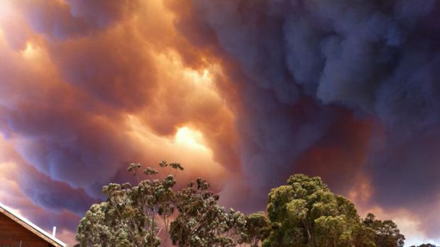 Flames lick at houses under bushfire threat near Margaret River. <i>Photo: Naomi Sime. </i>