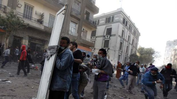 Egyptian protesters clash with security forces near Tahrir Square in Cairo, Egypt.