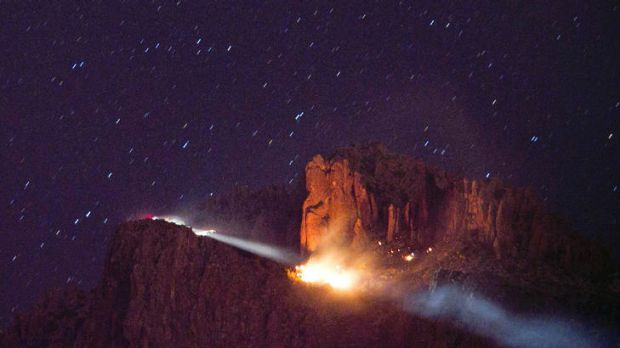 Three children dead ...  a floodlight illuminates a fire from a small plane crash in the Superstition Mountains in ...