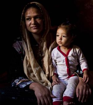 Families like Adeela Hamid and her daughter, Basmala, live in grinding poverty among the tombs.