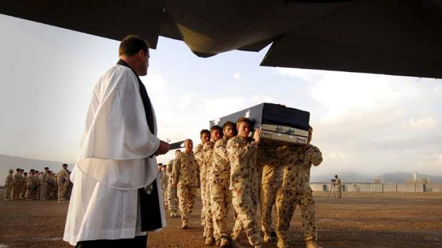 """A little better is everything to Afghans"" - Veteran James Brown. Above, the Bearer Party carry the casket of Corporal ..."