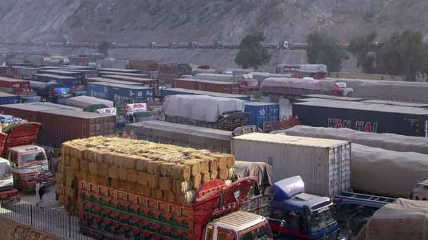 Cargo trucks, including those carrying supplies to NATO forces, are halted at the Pakistan-Torkham border as Pakistanis ...