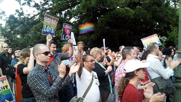 Supporters of the same-sex civil unions bill gather ahead of tonight's debate.
