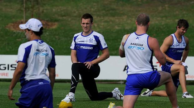 Going forward: Drew Petrie (second left) at North Melbourne's training session at Arden Street last night.