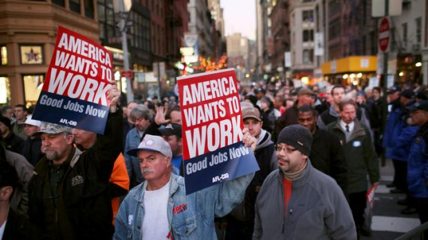 """Members of unions and Occupy Wall Street protesters take part in the """"March For Jobs and Fairness"""" in New York."""