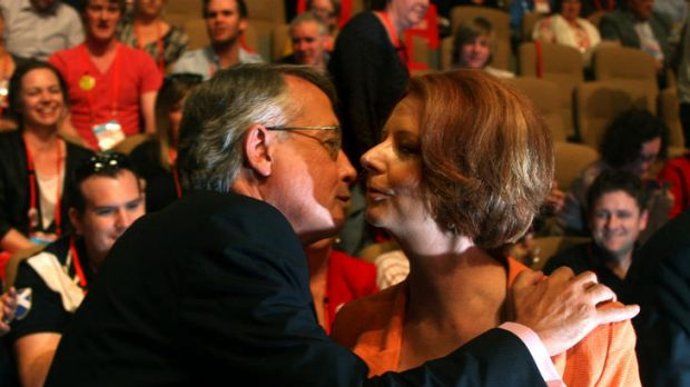 Treasurer Wayne Swan congratulates Julia Gillard after the sale of uranium to India was approved at the Labor Party ...