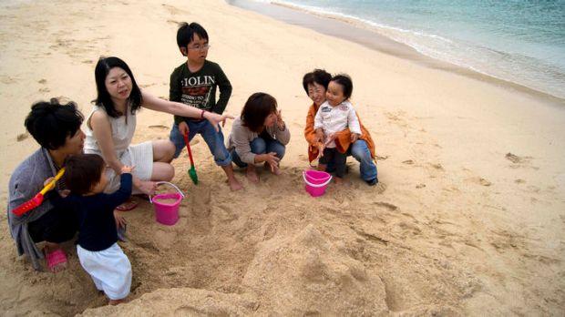 Fukushima fallout refugees meet at Naminoue beach in Okinawa