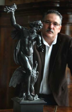 A fine figure … Colin Vickers and the bronze of Zeus that sold for $225,000.
