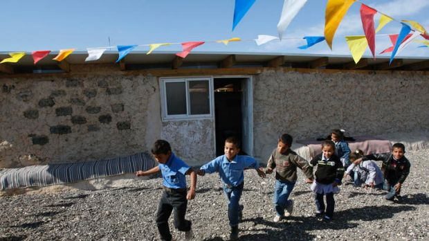 Uncertain future: Bedouin children play outside a school built of mud and car tyres on the West Bank that is likely to ...