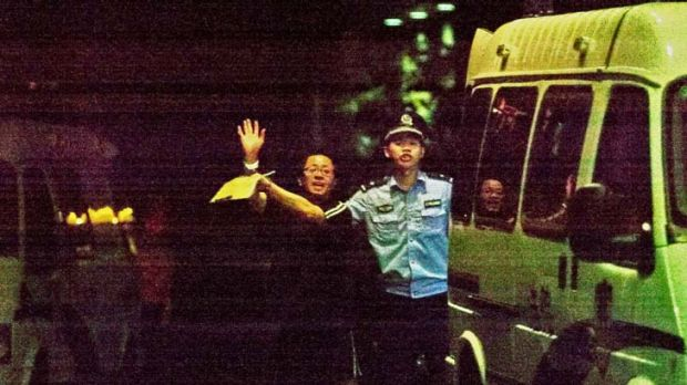 Chinese police take away Matthew Ng.