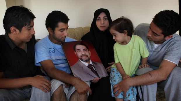 Wafaa Almaribe with her sons Mohammad, Jamal, Isaam and baby Wally with a photograph of her husband Mansor Almaribe.