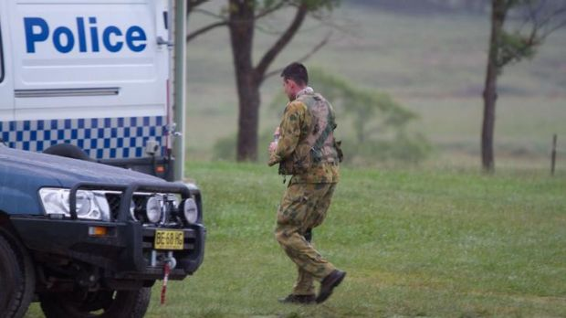 A policeman was wounded as officers approached a campsite.