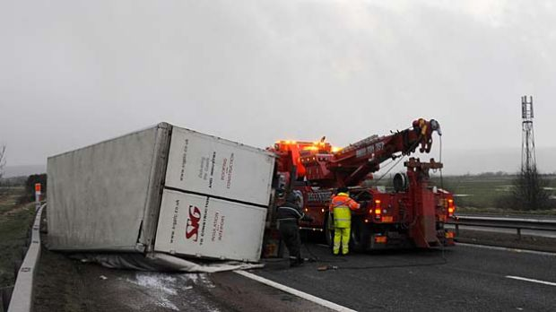 Blown over ... a lorry was turned on its side on the  southbound M9 motorway near Stirling, Scotland.
