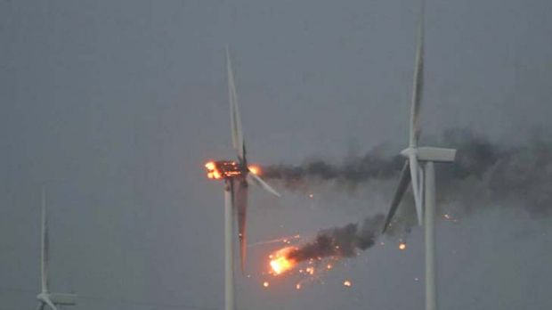 On fire ... strong winds forced this turbine to spin so quickly it burst into flames.