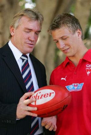 Father and son … Garry and Kieren Jack after Kieren was drafted to the Swans' rookie list in 2005.