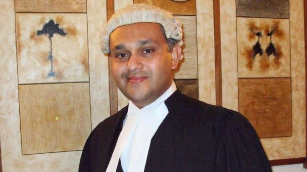 """Australian lawyer Julian Moti likened his extradition to kidnap, which he claimed was based on his """"physical complexion ..."""