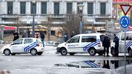 Police cars stand next to a huge Christmas tree in downtown Liege, Belgium Tuesday Dec. Officials say an armed man who ...