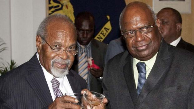 Welcome back … Somare and Ogio toast the swearing-in of the new Somare cabinet.
