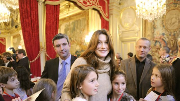 Public appearance ... Carla Bruni brings Christmas cheer to Parisian children.
