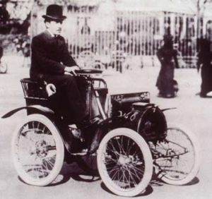 Entrepreneur ... Renault drives a miniature car in 1899.