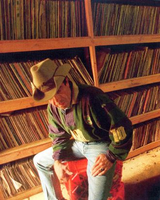 """Ian """"Molly """" Meldrum in his garage with part of his record collection in 1995."""