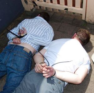 Bloody reign ...  Anthony Perish and Sean Waygood in the aftermath of their arrest by officers from Strike Force Tuno 2 ...