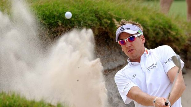 Ill wind: Ian Poulter splashes out of a bunker yesterday at the Australian Masters.