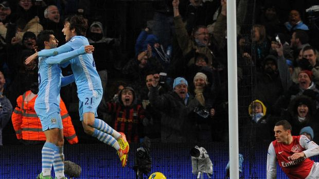 Manchester City's Spanish midfielder David Silva (second from left) celebrates with Sergio Aguero after scoring against ...