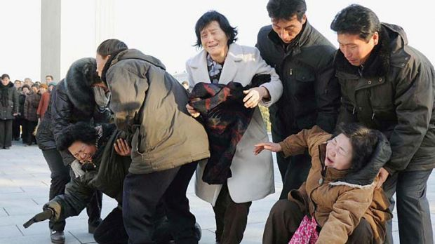Pyongyang residents react as they mourn the death of North Korean leader Kim Jong-il.