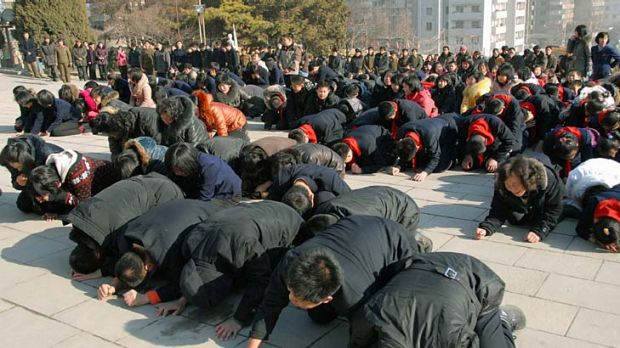 North Koreans cry after learning of the death of their leader Kim Jong-il.
