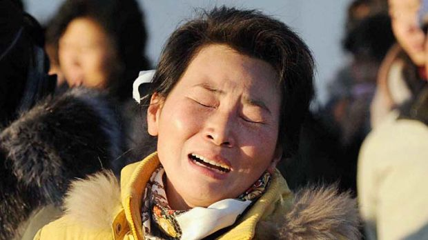 A mother and her son cry as they mourn the death of North Korean leader Kim Jong-il at a square on Mansu Hill in Pyongyang.